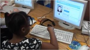 child typing text for VOKI avatar to read aloud